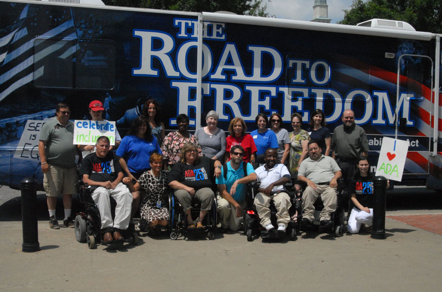 Greenville CAN members in front of the ADA tour bus.